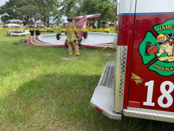 Firefighters secure the crash site of a small aircraft crash at the Leeward Air Ranch in Ocala on Wednesday morning. / Photo Credit: Marion County Fire Rescue
