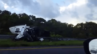 semi overturns on florida turnpike