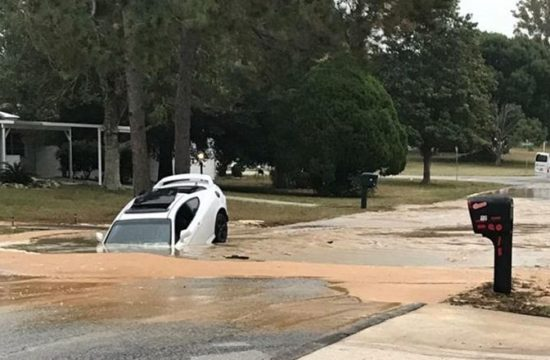 car swallowed whole by broken water main damage