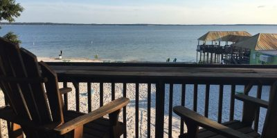 "View from ""Round House"" balcony overlooking Gator Joe's Beach on Lake Weir. Photo Credit: Gator Joe's via Facebook."
