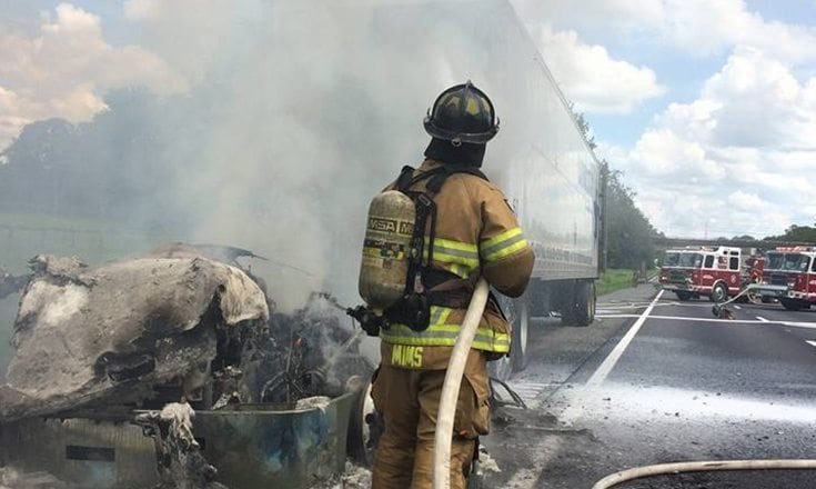 A semi-truck caught fire while traveling northbound on I-75 just north of Exit 358 in Ocala Friday afternoon.