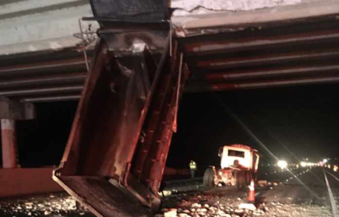 Traffic was backed up and diverted off of Interstate 75 after a dump truck collided with an overpass near Lake Panasoffkee.